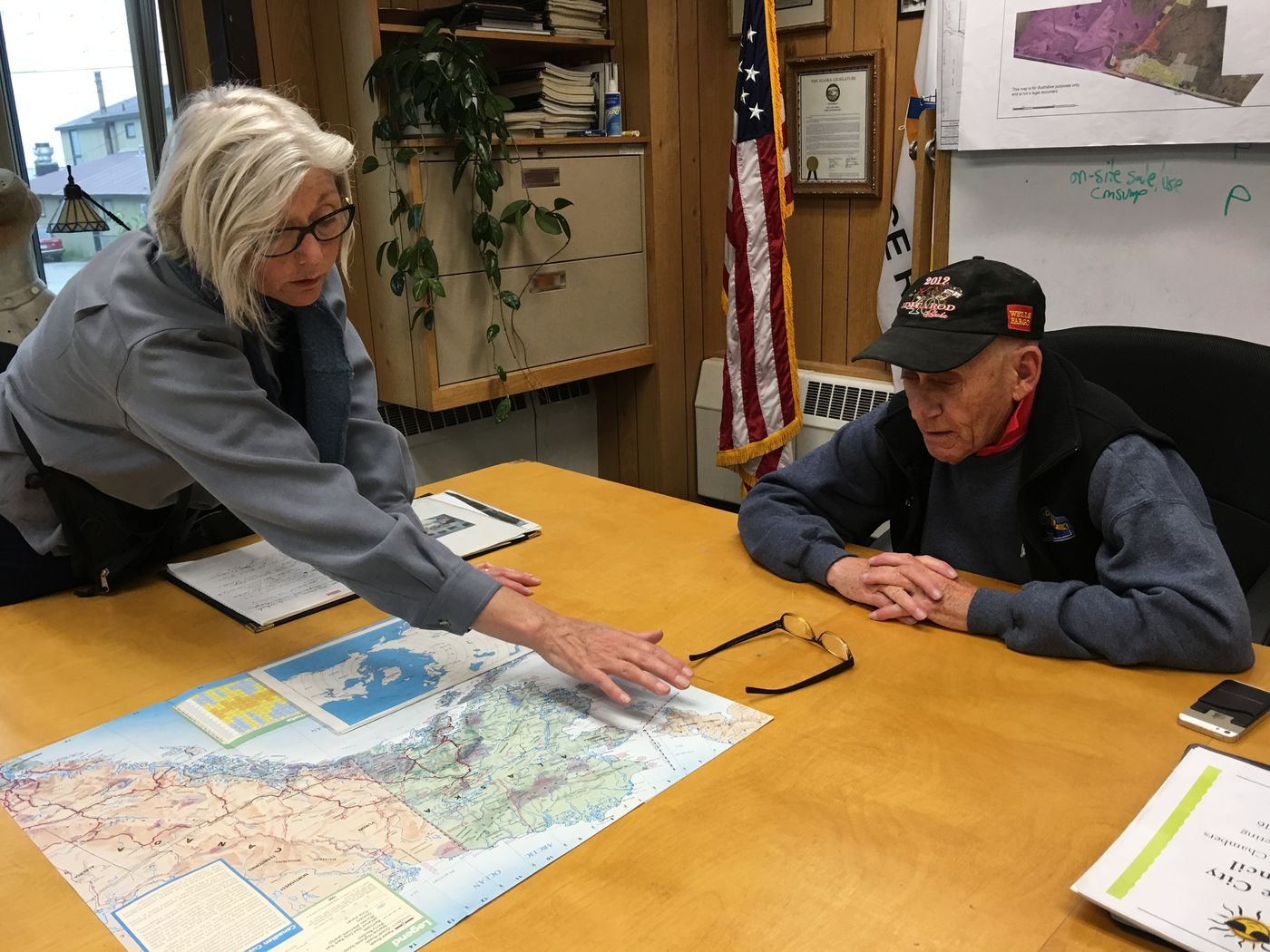 Tandy Wallack of Circumpolar Expeditions discusses the Diomede Island Family Reunion with Nome Mayor Richard Beneville. Both spoke about the need for closer relations across the Bering Strait. (Kirsten Swann / Alaska Dispatch News)