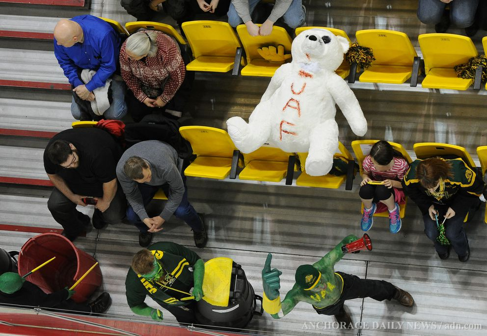A polar bear -- the mascot of the UAF Nanooks -- is a little worse for wear in the UAA section at a 2013 Governor's Cup hockey game at Sullivan Arena. (ADN archives)