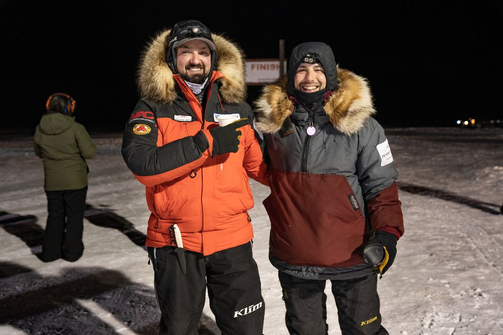 Richie Diehl (right) of Aniak is the 2021 Kuskokwim 300 Champion. This is Diehl's twelfth K300 and his first win. He's photographed with friend Pete Kaiser (left) of Bethel, a five-time K300 champion, on February 14, 2021, in Bethel, Alaska. (Katie Basile / KYUK)