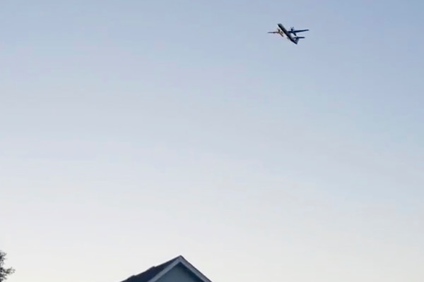 This photo taken from video provided by Courtney Junka shows the stolen Horizon Air turboprop plane flying over Eatonville, Wash., Friday, Aug. 10, 2018. Officials say an airline employee stole an empty Horizon Air turboprop plane with no passengers aboard, and took off from Sea-Tac International Airport in Washington state on Friday night before crashing into a small island. The Pierce County Sheriff's Department says preliminary information suggests the crash occurred because the 29-year-old man was