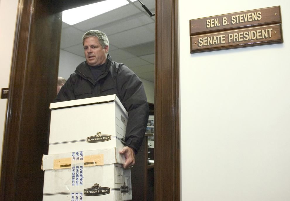 An FBI agent removes boxes from the office of Senate President Ben Stevens in the 2006 raid at the state Capitol in Juneau. (Michael Penn / Juneau Empire file)