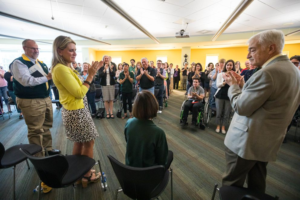 People applaud UAA Chancellor Cathy Sandeen during an 'ask me anything ' forum on Friday, Aug. 2, 2019 at the UAA/APU Consortium Library. The group was responding to her performance Tuesday during a University of Alaska board of regents meeting where she advocated against a single accreditation model for the UA system. (Loren Holmes / ADN)