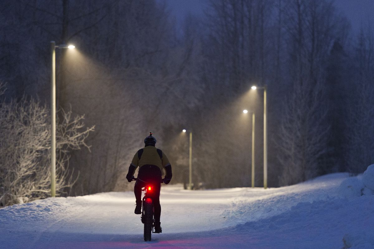 A bicyclist rides westbound on the Chester Creek Trail near Arctic Boulevard on January 18, 2019. (Marc Lester / ADN)