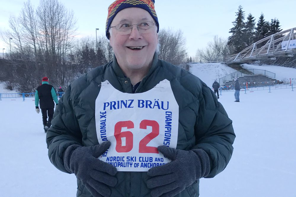 Tom Nelson, 76, shows a bib from the 1978 national championships at Kincaid Park.