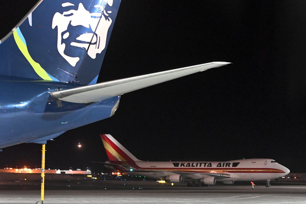 A Kalitta Air Boeing 747 carrying U.S. citizens being evacuated from Wuhan, China, made a refueling stop at the north terminal at Ted Stevens Anchorage International Airport on Tuesday evening. (Bill Roth / ADN)