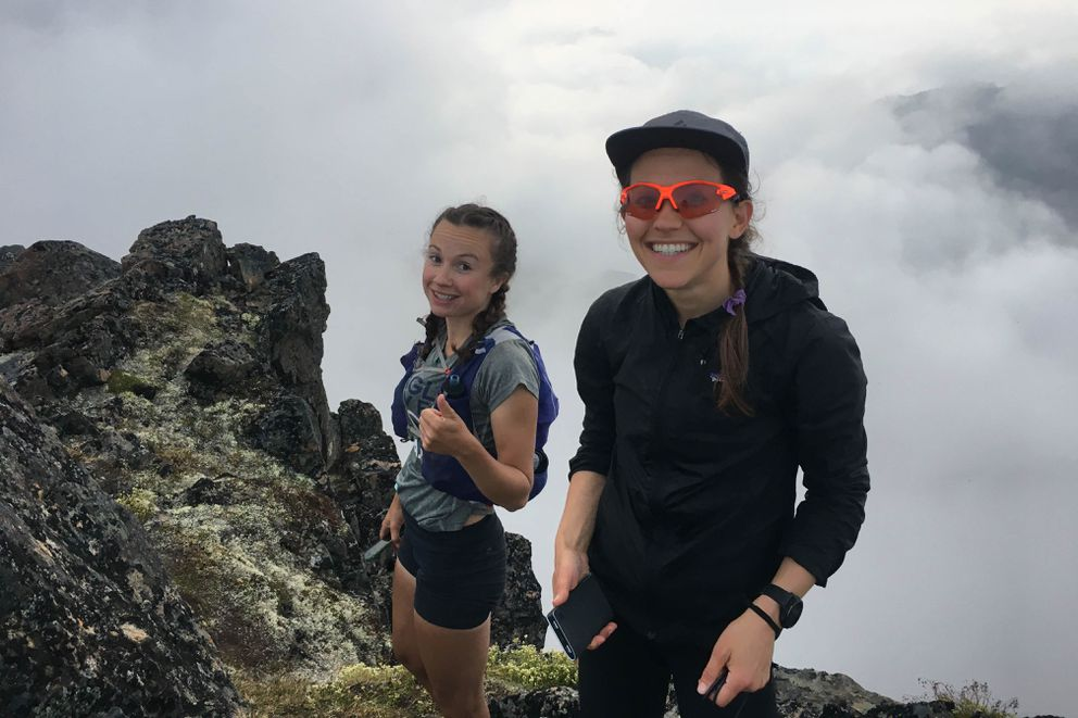 Abby Jahn, left, and Julianne Dickerson pause at the top of 5,150-foot O'Malley Peak. (Photo by April McAnly)