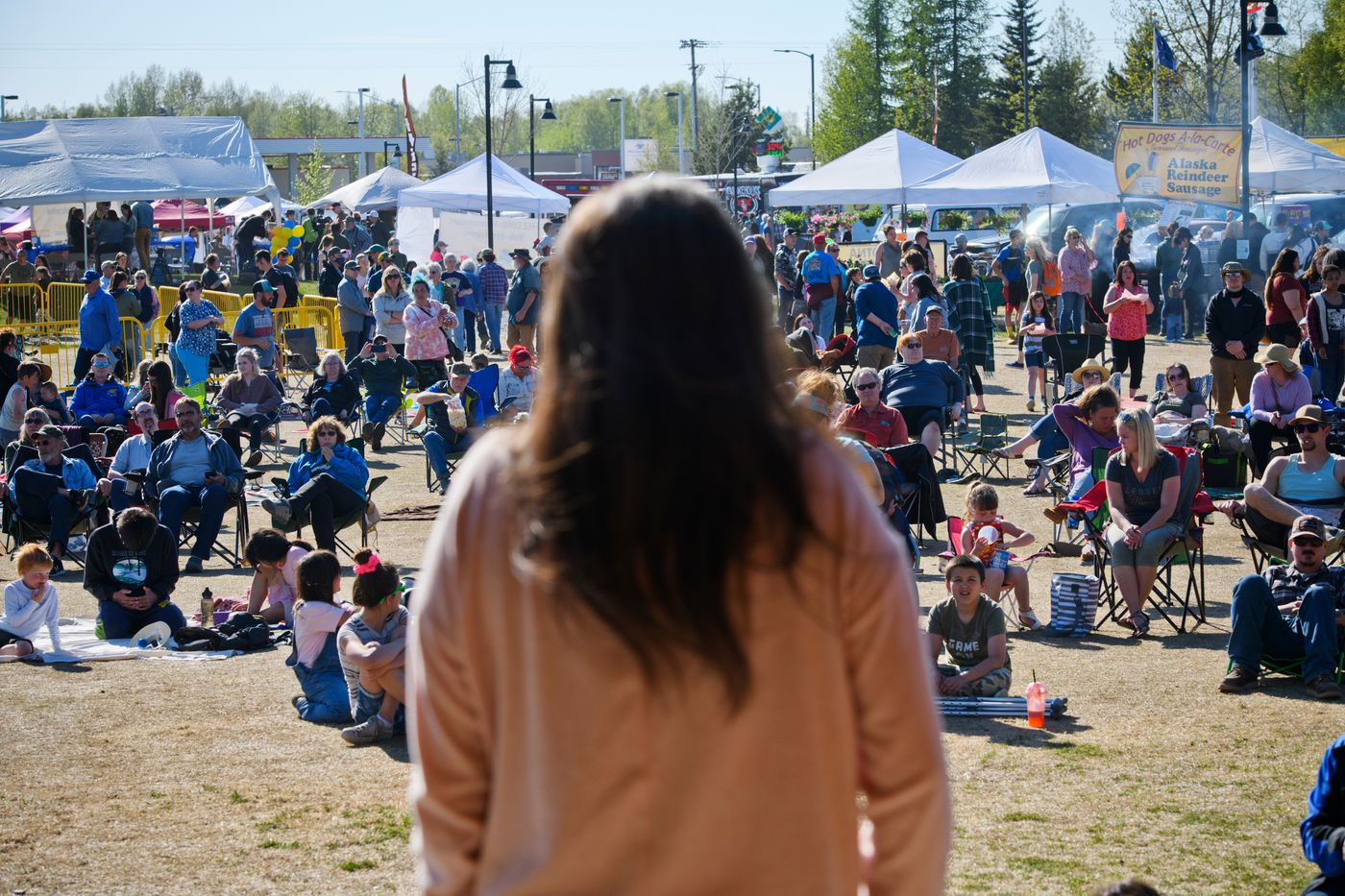 Anne Zink, Alaska's chief medical officer, speaks to a crowd at the Party in the Park at Soldotna Creek Park on May 26, 2021. (Marc Lester / ADN)