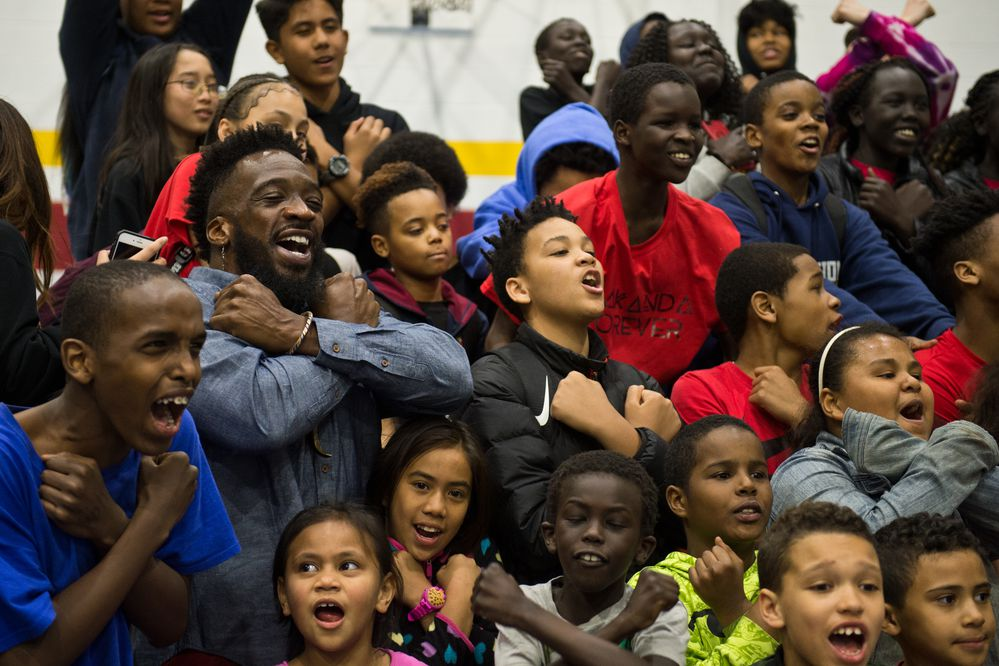 Travis Love, who portrayed a Jabari warrior in the film Black Panther, poses with kids at the Mountain View Boys and Girls Club on April 13, 2018. (Marc Lester / ADN)