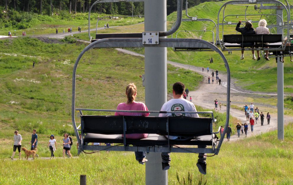 Visitors take free rides up Chair 7 and free walks back down Blueberry Hill while attending the Blueberry Festival in Girdwood. (Erik Hill / ADN)
