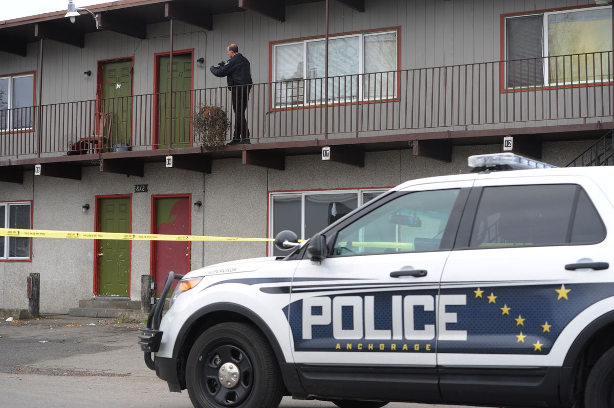Anchorage police investigate the scene of a fatal shooting in Spenard on Wednesday morning. (Bill Roth / Alaska Dispatch News)