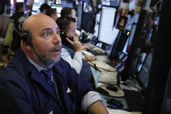 Trader Vincent Napolitano works on the floor of the New York Stock Exchange, Monday, Dec. 3, 2018. Stocks are opening sharply higher on Wall Street, following gains in overseas markets after the U.S. and China struck a 90-day truce in their trade dispute. (AP Photo/Richard Drew)
