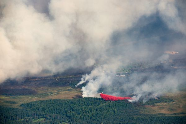 Red fire retardant is dropped from a plane on one edge of the Sockeye Fire near Willow on Monday, June 15, 2015.