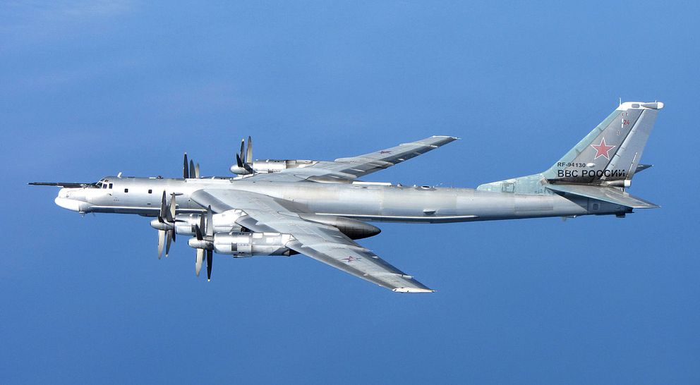 A Russian Tu-95 Bear bomberphotographed from a U.K. air force jetin Scotland in 2014. (Royal Air Force / U.K Ministry of Defense via Wikimedia Commons)