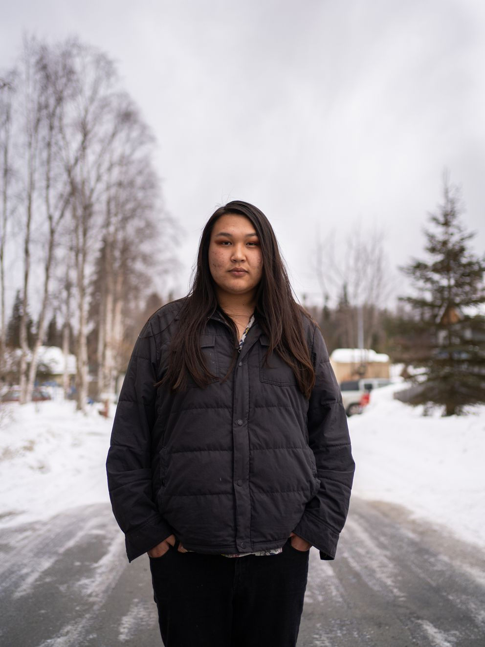 Alex Carter, 21, outside her home in Anchorage on April 8. (Ash Adams for The Marshall Project and NPR)
