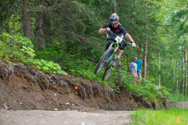 Cody Gauer speeds downhill on a single-track bike trail on the Hillside during the second annual Gambler Enduro mountain bike race Friday night. Gauerfinished 11th in the men's division. (Photo by Cheryl Matyas)