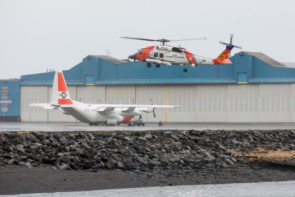 A HH-60J Jayhawk helicopter comes in for a landing at Coast Guard Air Station Kodiak on Thursday, Jan. 24, 2019. Behind is a HC-130H Hercules aircraft. (Loren Holmes / ADN)