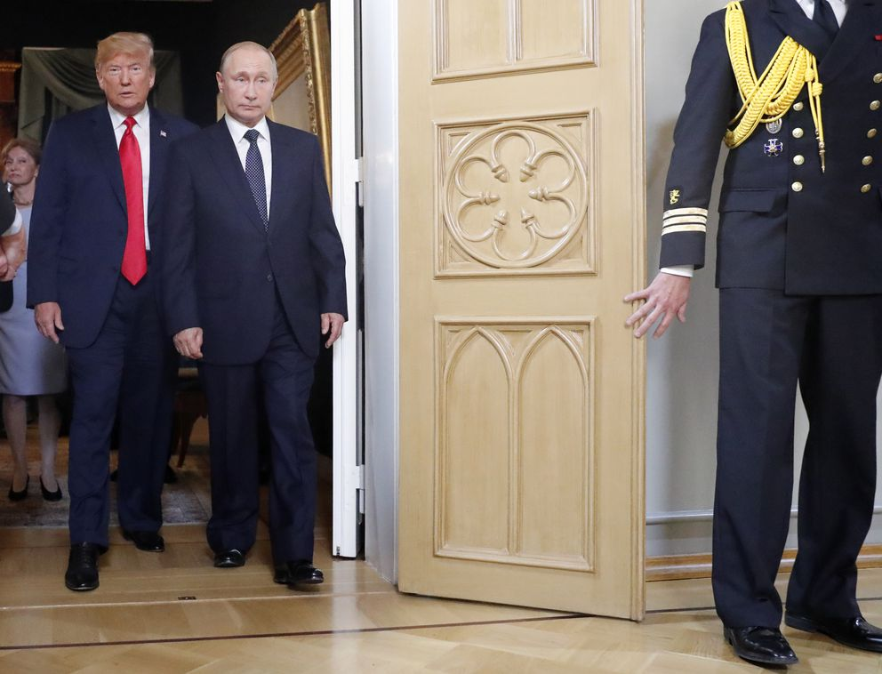 U.S. President Donald Trump, left, and Russian President Vladimir Putin arrive for a one-on-one-meeting at the Presidential Palace in Helsinki, Finland, Monday, July 16, 2018. (AP Photo/Pablo Martinez Monsivais)