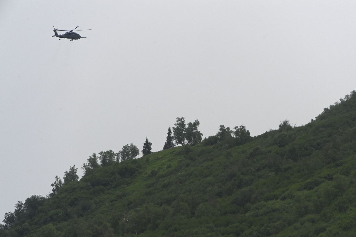 An Alaska Air National Guard HH-60G Pave Hawk helicopter from the 210th Rescue Squadron searches for a missing hiker on Wednesday, June 16, 2021. A woman reported early Tuesday morning that she encountered bears while hiking on the Pioneer Ridge Trail. (Bill Roth / ADN)