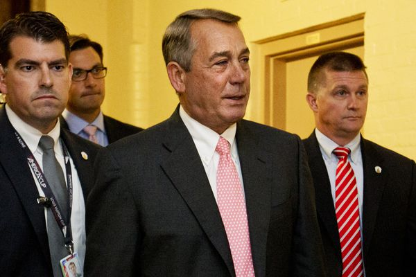 House Speaker John Boehner of Ohio, center, leaves a meeting with House Republicans on Capitol Hill in Washington on Friday.