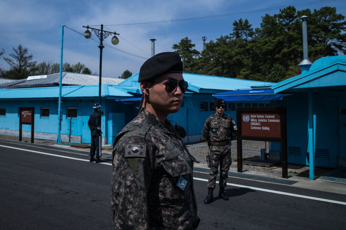 Soldiers stand guard outside the meeting rooms that straddle the border between the North and South Korea in the Demilitarized Zone in South Korea, April 19, 2017. (Lam Yik Fei/The New York Times file)