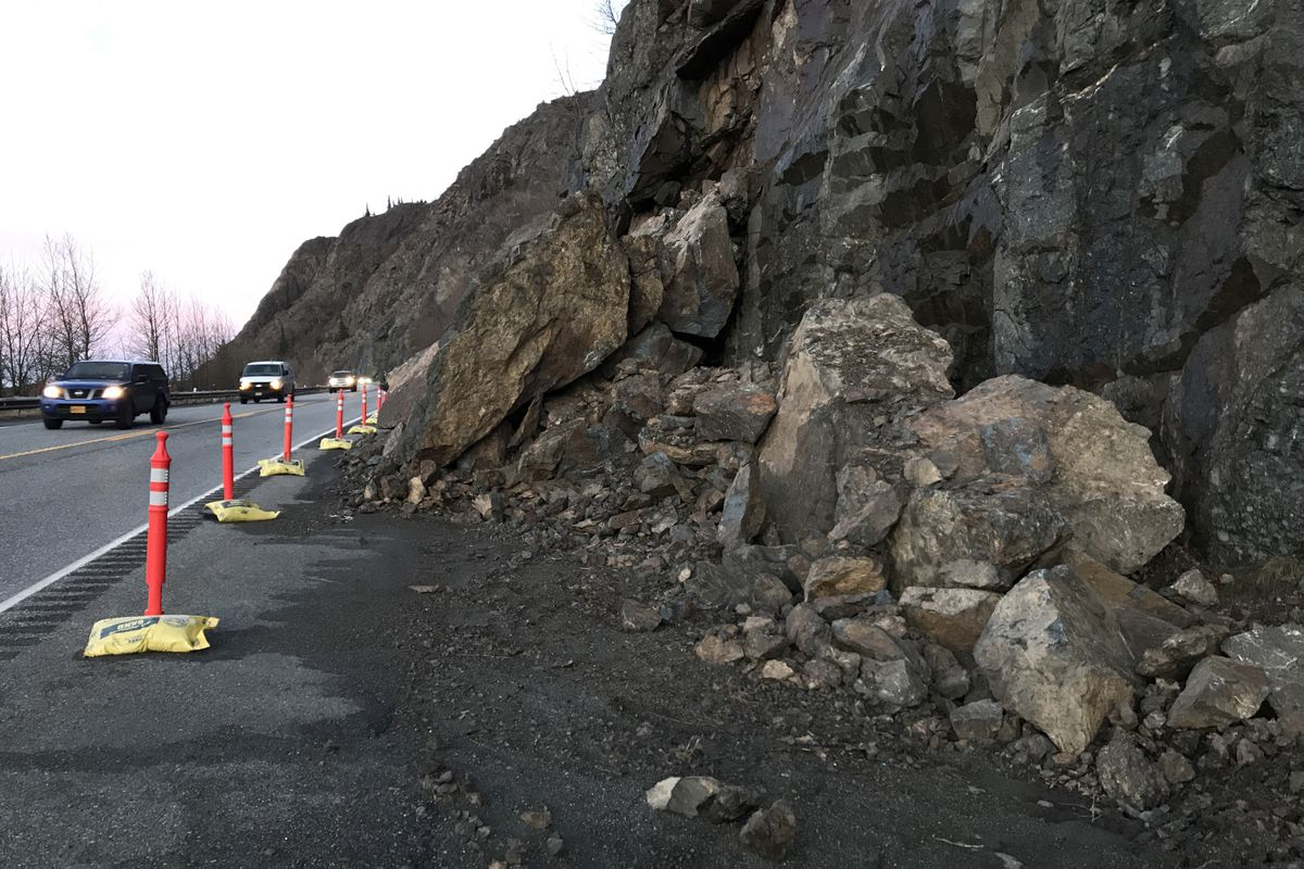 Motorists drive by debris from a rock slide at mile 109 on the Seward Highway Tuesday morning, Dec. 10, 2019. (Bill Roth / ADN)