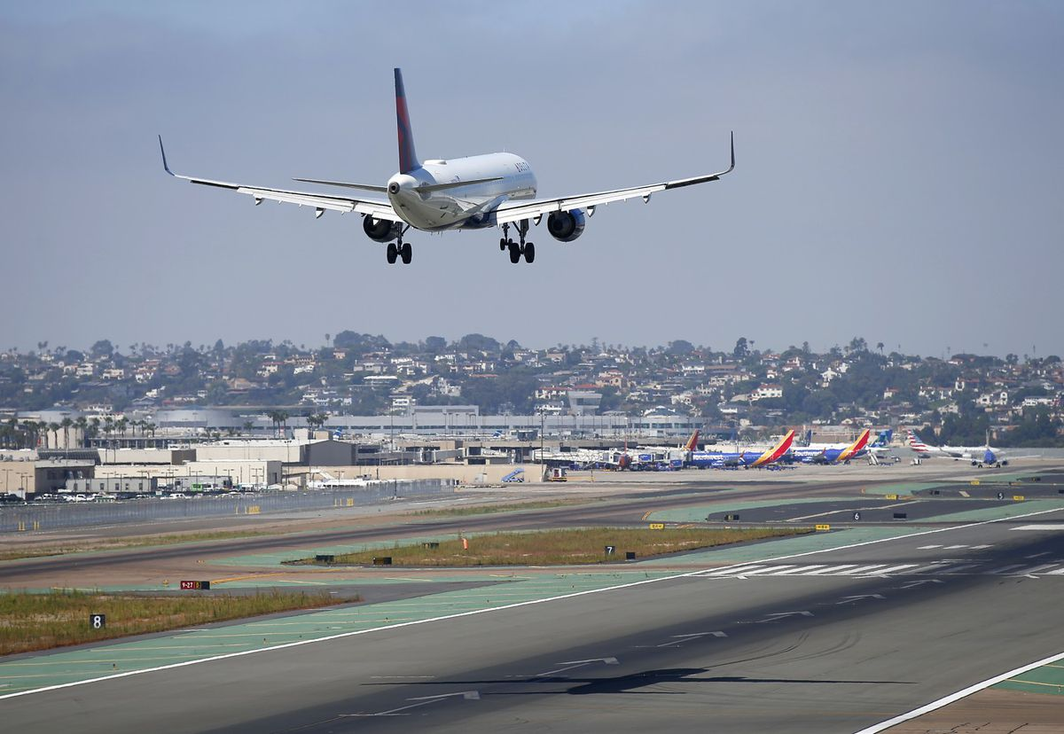 A Delta Airlines jet approaches San Diego International Airport for a landing after flying from Atlanta on August 29, 2019. (K.C. Alfred/The San Diego Union-Tribune/TNS)