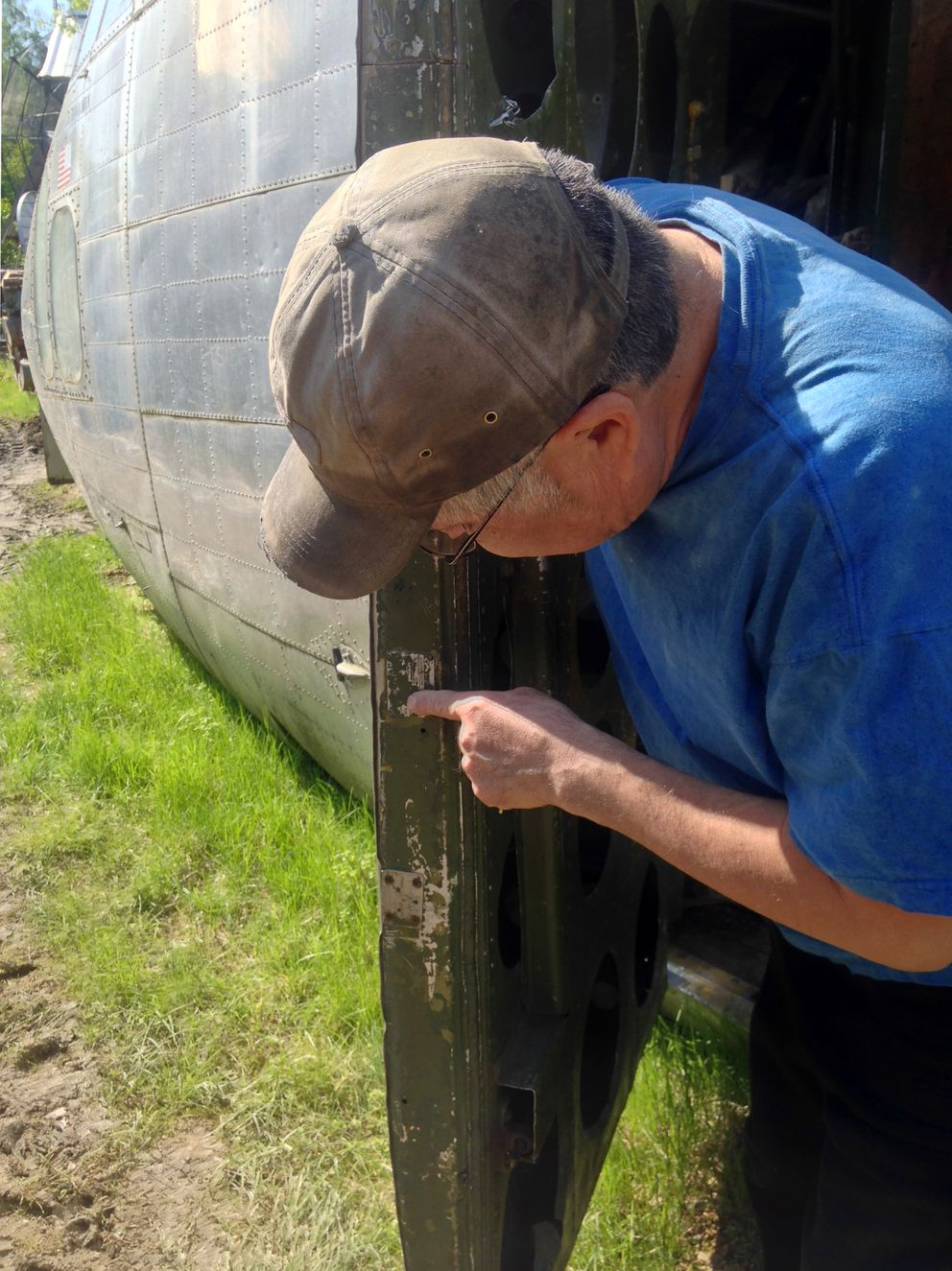 Rudy Hamilton points to the original aircraft serial number on the plane door.(Laurel Andrews / Alaska Dispatch News)