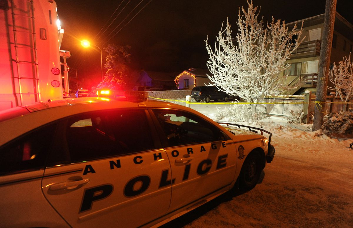 Anchorage police investigate a double homicide at the 4100 block of Peterkin Avenue in Mountain View in Anchorage. (Bob Hallinen / Alaska Dispatch News)