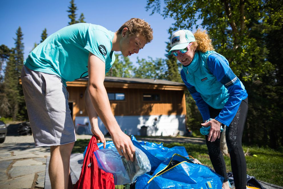 Canyon Tobin, 19, and his mom, Nora Miller, sort through their Denali expedition gear on Tuesday, June 12.  (Loren Holmes / ADN)