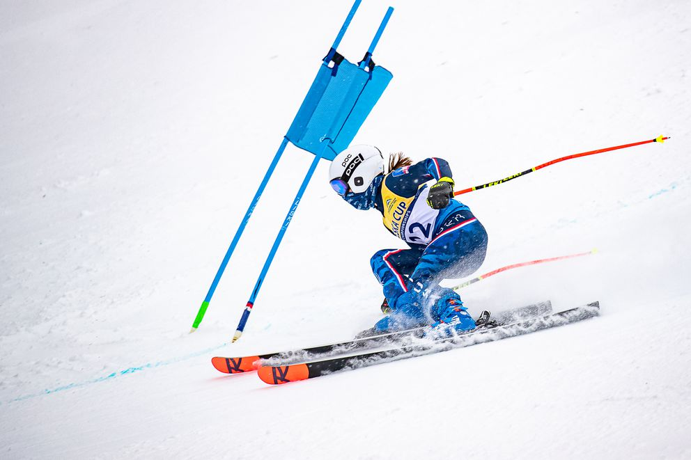 Alyeska Ski Club's Ava Huey battles a sudden uphill gust of wind that deflects the gate panel on the steep Waterfall pitch in the first of two U12/U14 Alyeska Cup Super-Gs on Thursday. (Photo by Bob Eastaugh)