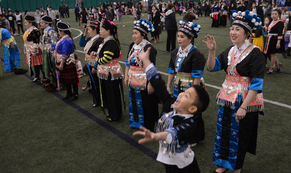A young boy tries to intercept a ball during the Hmong New Year's celebration at the Dome. (Bob Hallinen / Alaska Dispatch News)