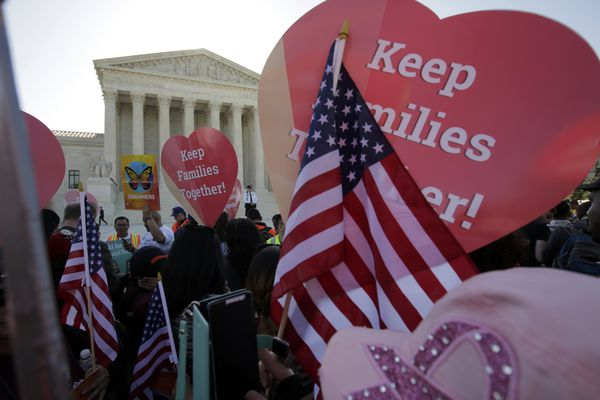 Immigration activists rally outside the U.S. Supreme Court on Monday as justices hear arguments in a challenge by 26 states over the constitutionality of President Barack Obama's executive action to defer deportation of certain immigrant children and parents who are in the country illegally.