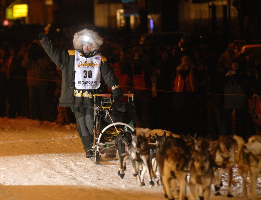 Jeff King celebrates his fourth Iditarod win as he heads down Front Street in Nome earlly Wednesday, March 15, 2006. (Marc Lester/ADN archive)