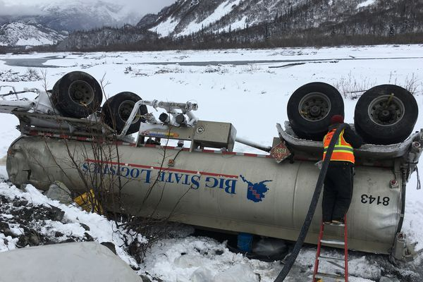 Big State Logistics response crew offload fuel from a rolled and damaged tanker trailer at Mile 42 of the Richardson Highway on Friday, Oct. 21, 2016. (Candice Bressler/Alaska DEC)