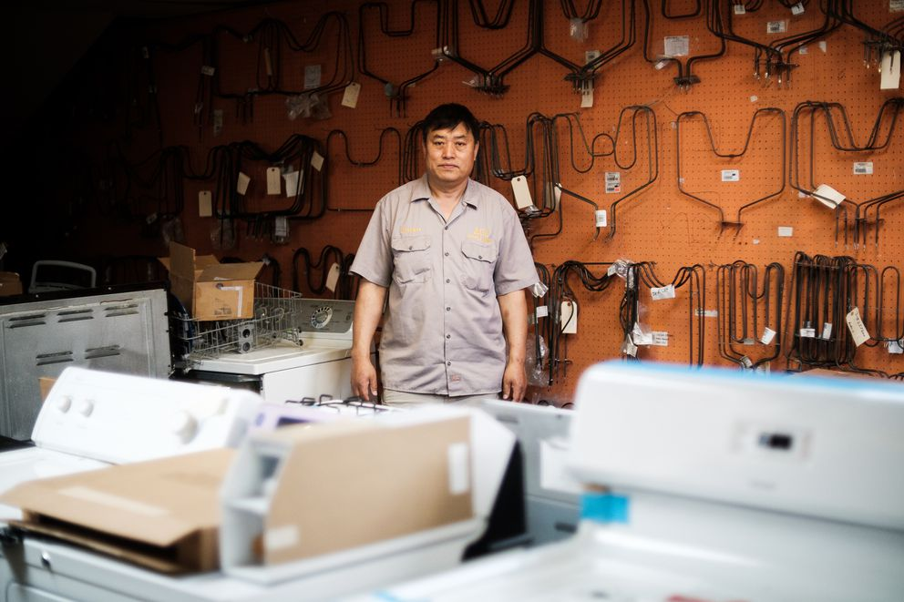 Chun B. Park of Ace Appliance stands in his shop surrounded by home appliances and spare parts. Park has been repairing washers, dryers, dishwashing machines and refrigerators in Alaska for more than 20 years. (Young Kim / Alaska Dispatch News)
