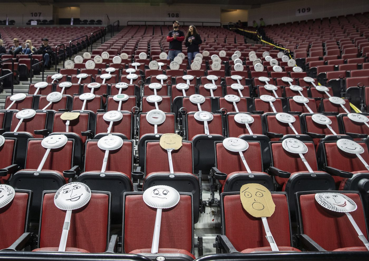 The Auburn fan section got creative by placing paper plate faces on the seats during the Class 1C boys high school basketball tournament championship game against Ogallala at Pinnacle Bank Arena, Saturday, March 14, 2020, in Lincoln, Neb. Crowds were limited to staff and immediate family due to concerns over the coronavirus. (Chris Machian/Omaha World-Herald via AP)