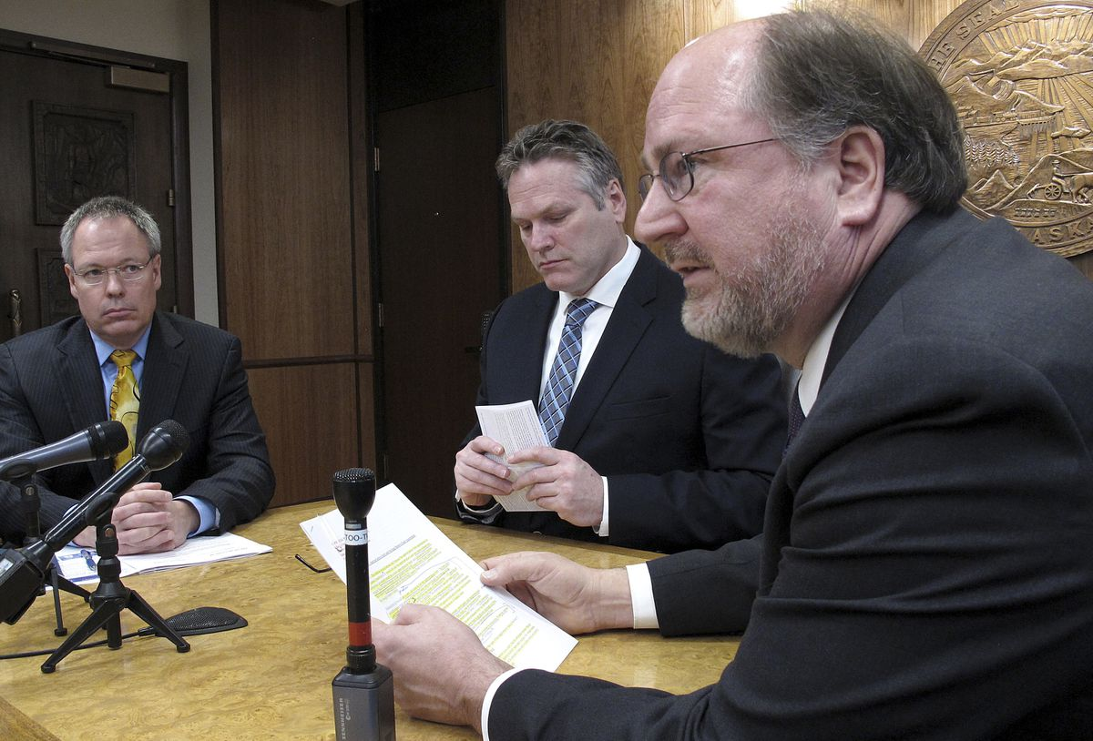 This photo from Jan. 30, 2019, shows Attorney General Kevin Clarkson, right, during a news conference with state Revenue Commissioner Bruce Tangeman, left, and Gov. Mike Dunleavy, center, in Juneau. (AP Photo/Becky Bohrer)