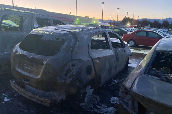 A fire destroyed at least four cars at the Lithia Kia of Anchorage early Thursday morning. Anchorage police and the fire department are conducting an arson investigation. (Eric Connick photo)