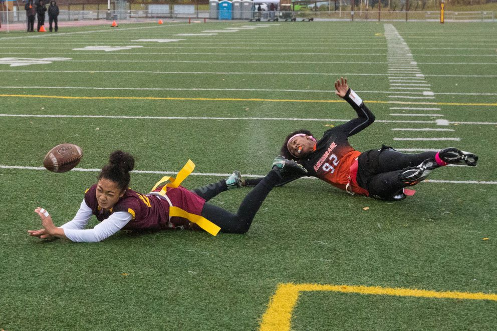 Dimond's Skylar Coleman and West's Ah'Kayzee Galloway-Davis tumble trying to catch the ball Saturday. (Loren Holmes / ADN)