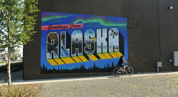 "The ""Greetings from Alaska"" mural is on the side of the Anchorage Downtown Partnership building in Anchorage, AK on Saturday July 7, 2018.  (Bob Hallinen / ADN)"