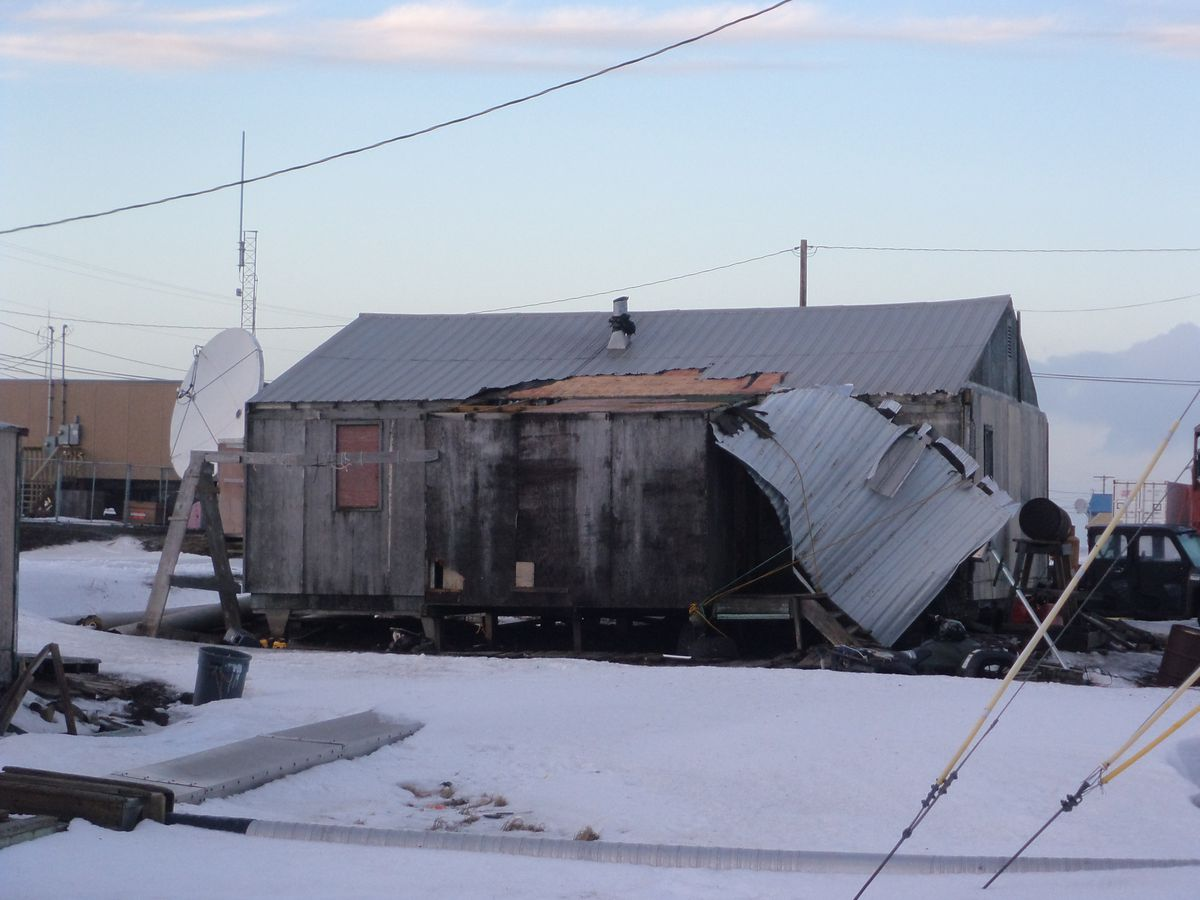 State officials say about 30 homes in Savoonga, on St. Lawrence Island in the Bering Sea, were damaged, including lost roofs, during a pair of winter storms that swept through Western Alaska during the final week of 2016. (Courtesy City of Savoonga via DHSEM)