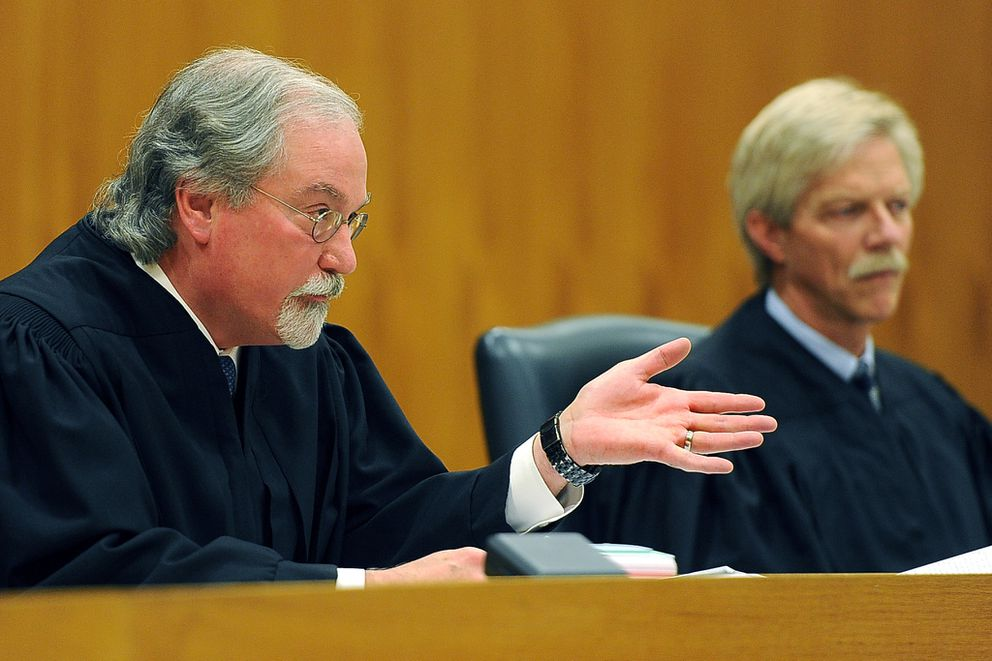 Chief Justice Craig Stowers, left, questions attorney Louisiana Cutler as Justice Peter Maassen listens during oral arguments on school funding before the Alaska Supreme Court on Wednesday, September 16, 2015, at Boney Courthouse.