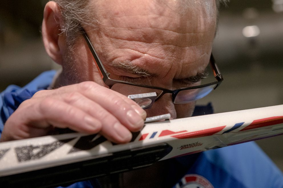 The Norwegian wax tech Terje Fardal scrutinizes a ski in Pyeongchang, South Korea, on Feb. 12, 2018. A wax tech's job is to divine the right combination of wax, skis and snow at a given race — a puzzle with thousands of possible solutions. (Hilary Swift/The New York Times)