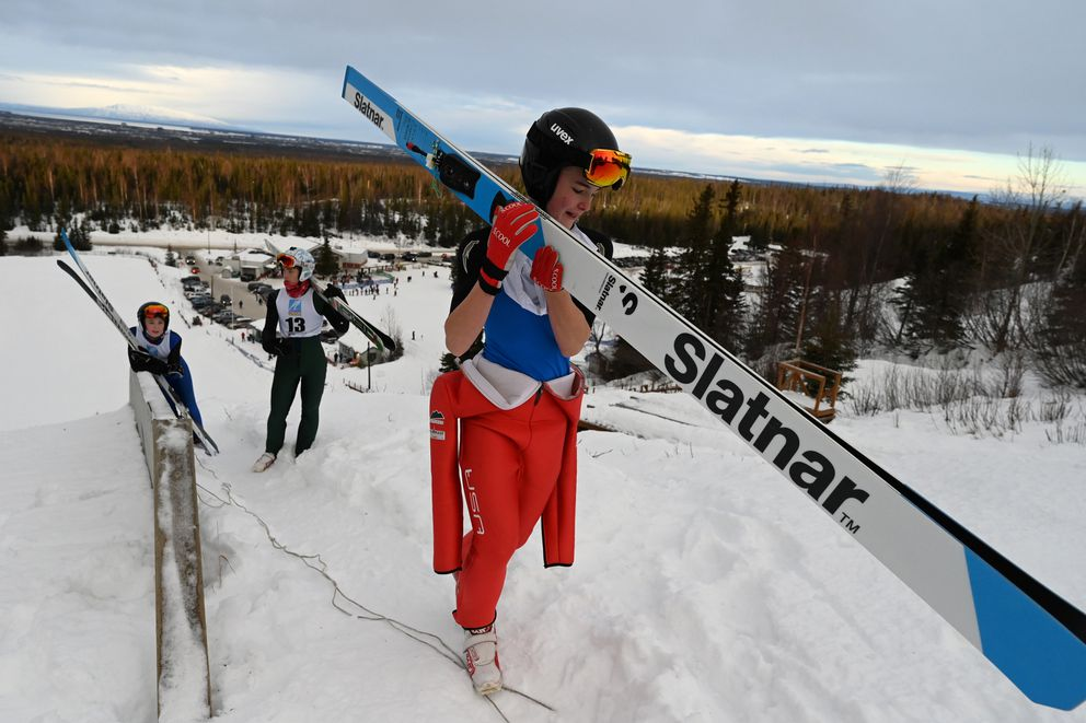 Skyler Amy of Team AK walks up the hill during the jumping portion of Sunday's nordic combined event. (Bill Roth / ADN)