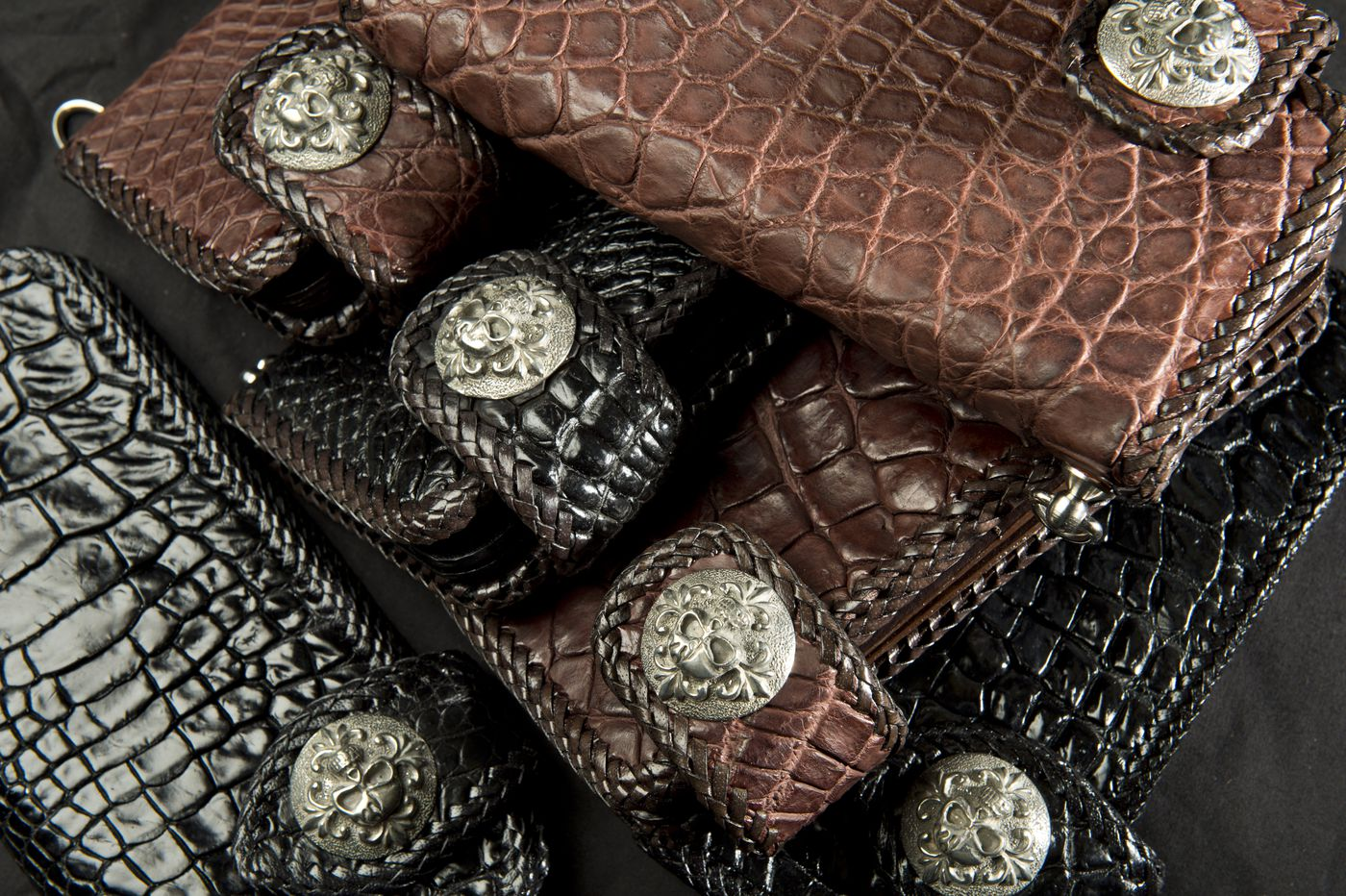 These wallets, coming into the U.S. from Thailand, are made from Siamese crocodile skin, an endangered animal. They were abandoned with Fish and Wildlife. (Marc Lester/ ADN)
