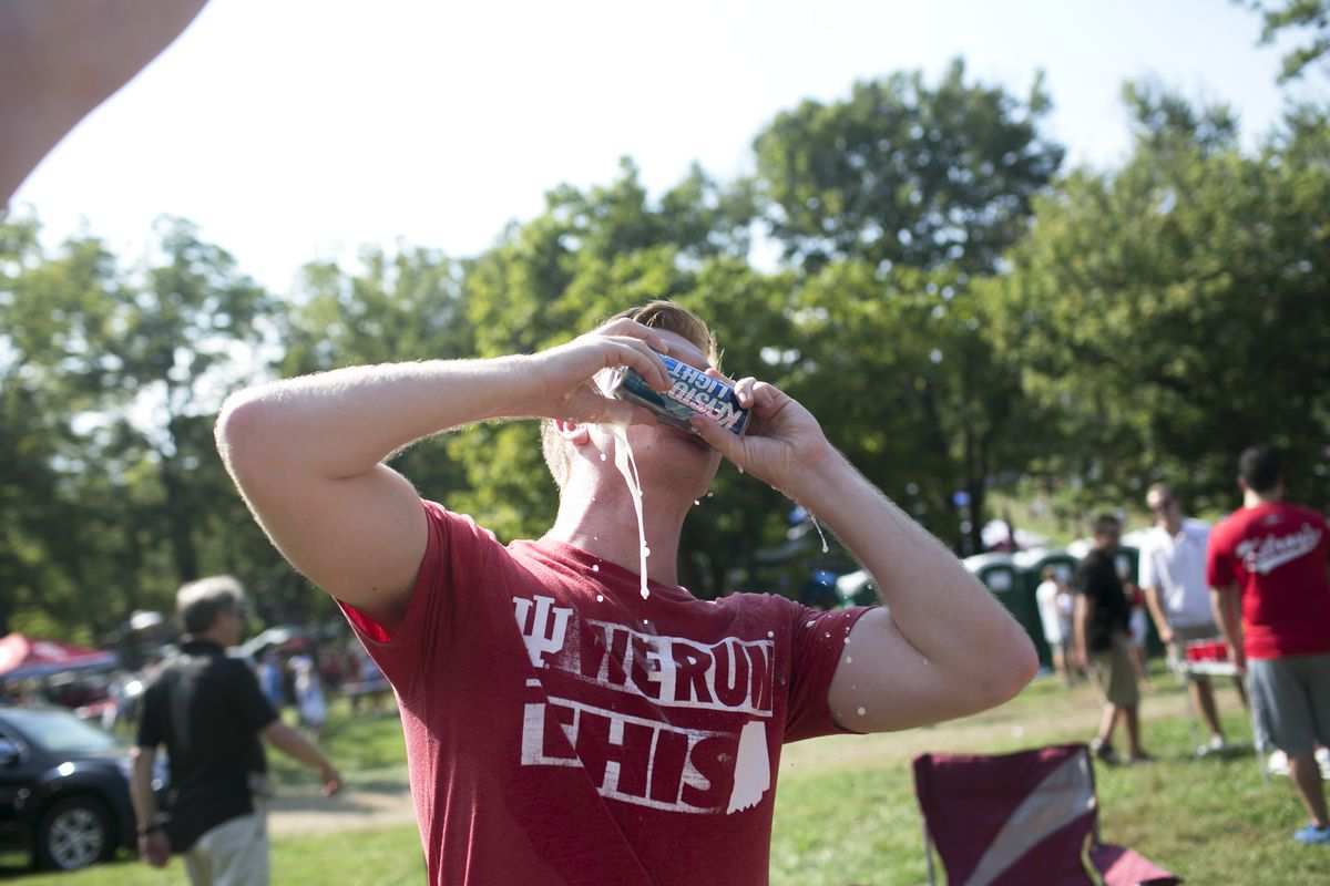 A student drinking before a Indiana University football game in Bloomington, Ind., on Sept. 24. (Maddie McGarvey / The New York Times)
