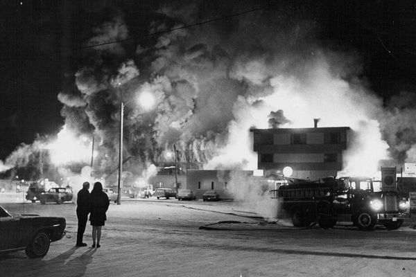 WALLS OF FLAME SWEEP LENGHT OF MOTEL--Searing flames quickly destroyed the Gold Rush Motor Lodge on Northern Lights Boulevard, at the southern City limits of Anchorage today, sweeping from the front dining room area at the right of photo along the length of building, to the left in the picture. State Troopers reported that 34 rooms, were occupied when the fire broke out, with between 40 and 43 persons in the building on the time. January 1970