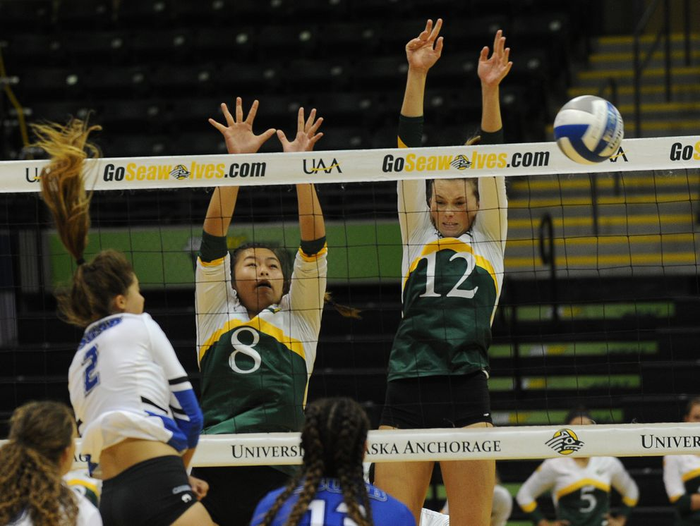 Lauren Nicholson of Cal State San Bernardino is blocked by Cindy Tran and Amber Rose of Concordia-Irvine. (Bob Hallinen / Alaska Dispatch News)