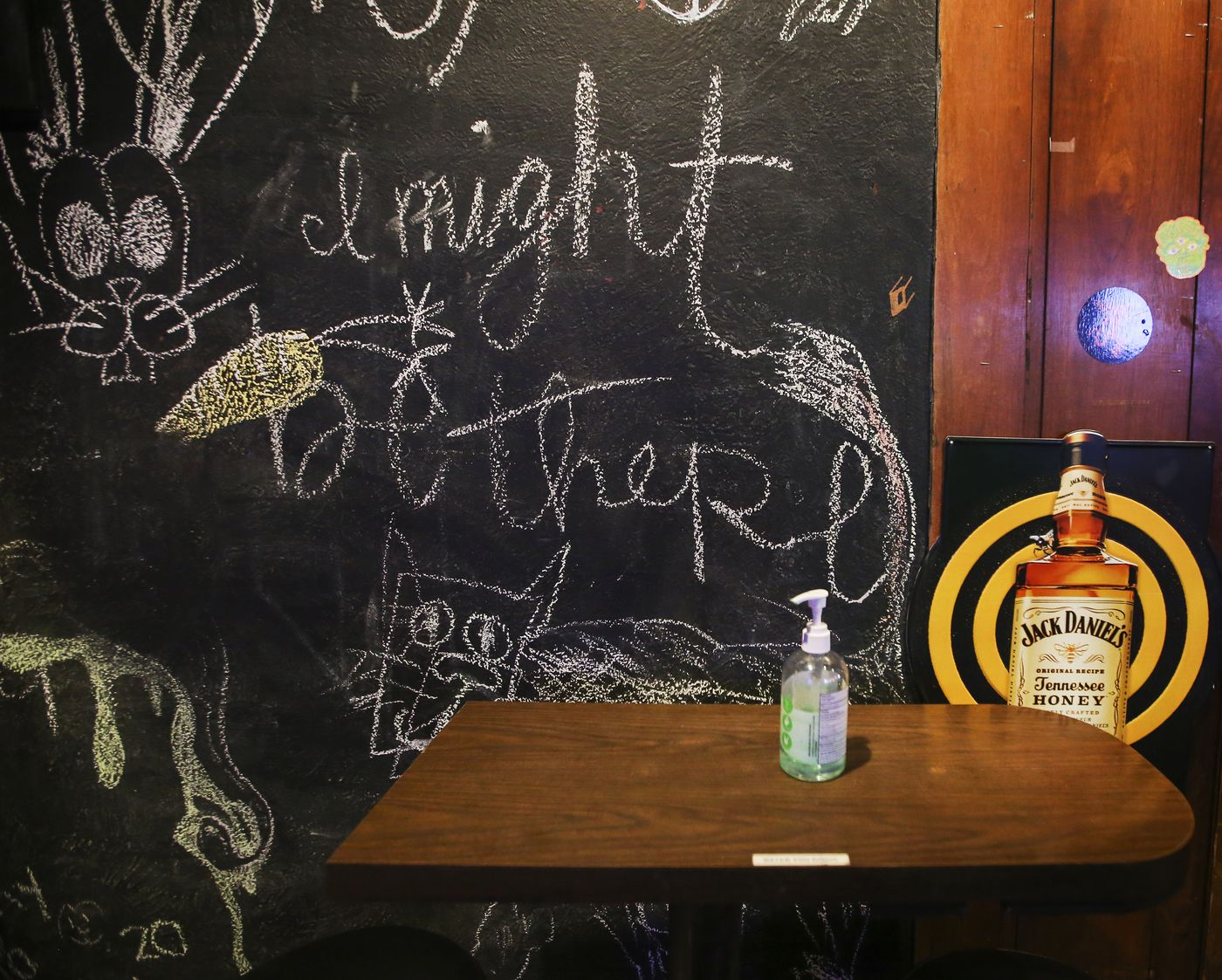 A bottle of hand sanitizer rests on an empty table near the restrooms at Van's Dive Bar in downtown Anchorage on Thursday, Jan. 14, 2021. (Emily Mesner / ADN)
