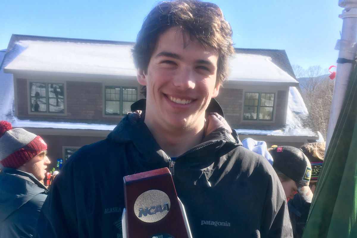 UAA freshman Liam Wallace holds the trophy he was awarded Saturday for his runnerup finish in the men's slalom race at the NCAA Ski Championships in Stowe, Vermont, on March 9, 2019. (Photo provided by UAA Athletics)